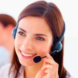 Portrait of an attractive happy young customer representative wearing headset